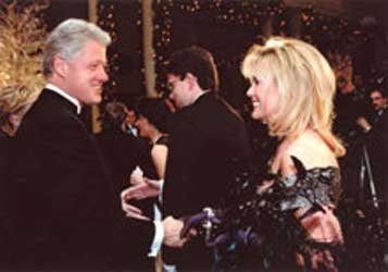 Bill Clinton | Debbie Simon wearing Constance McCardle Gown